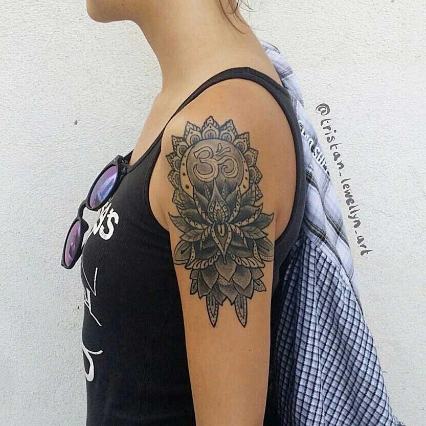 blackwork-style-tattoo-of-lotus-on-upper-arm
