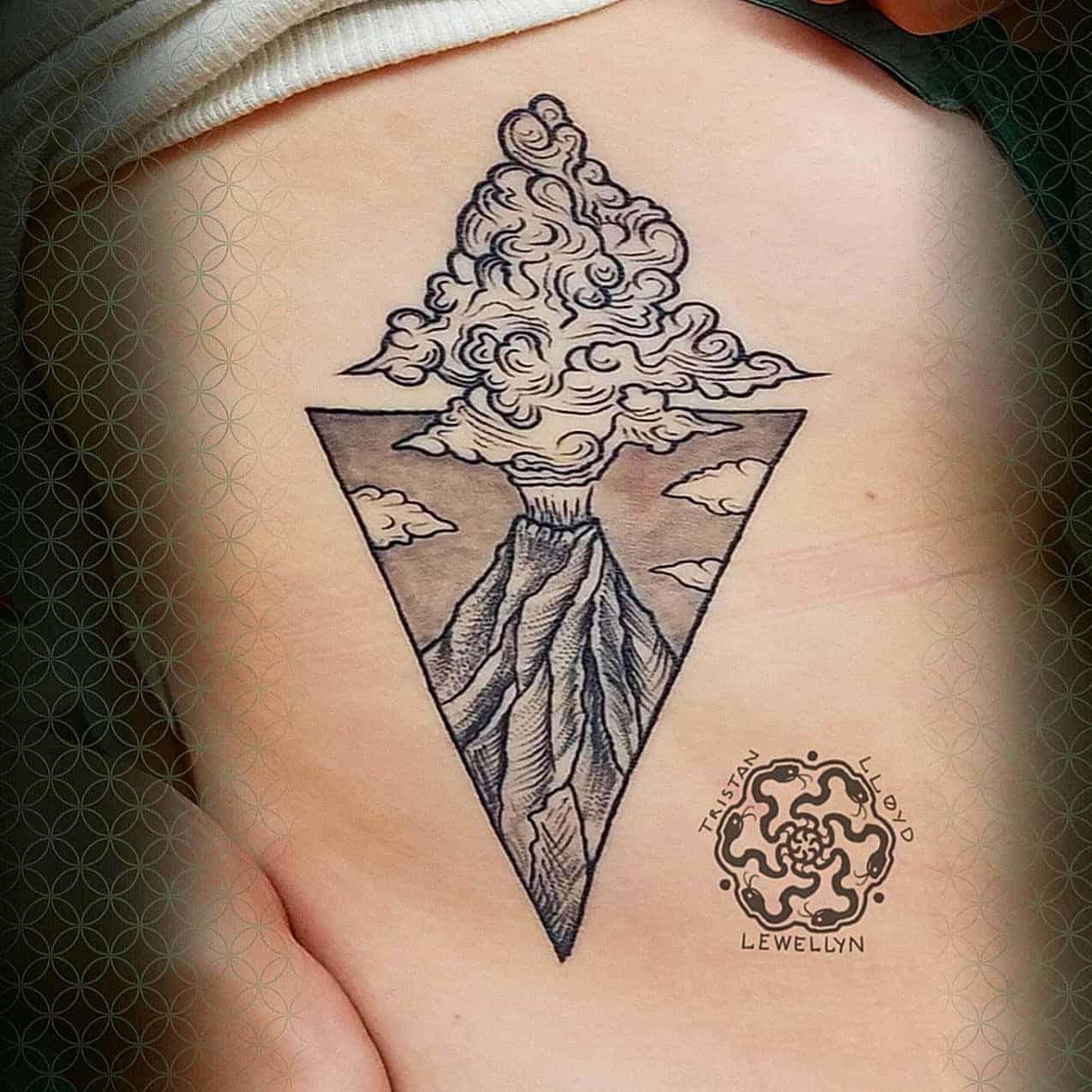 blackwork tattoo of a volcane on ribs