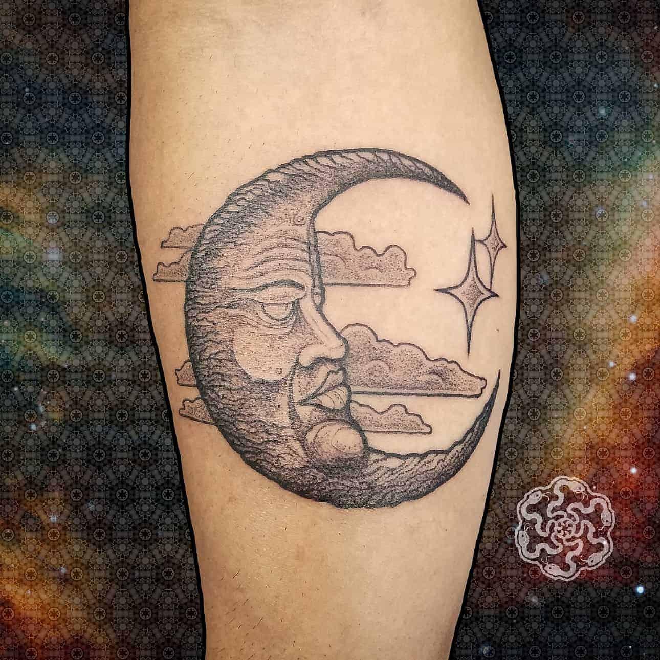 blackwork tattoo of crescent moon on a forearm