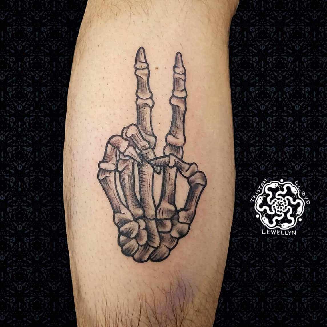 blackwork tattoo of skeleton piece sign