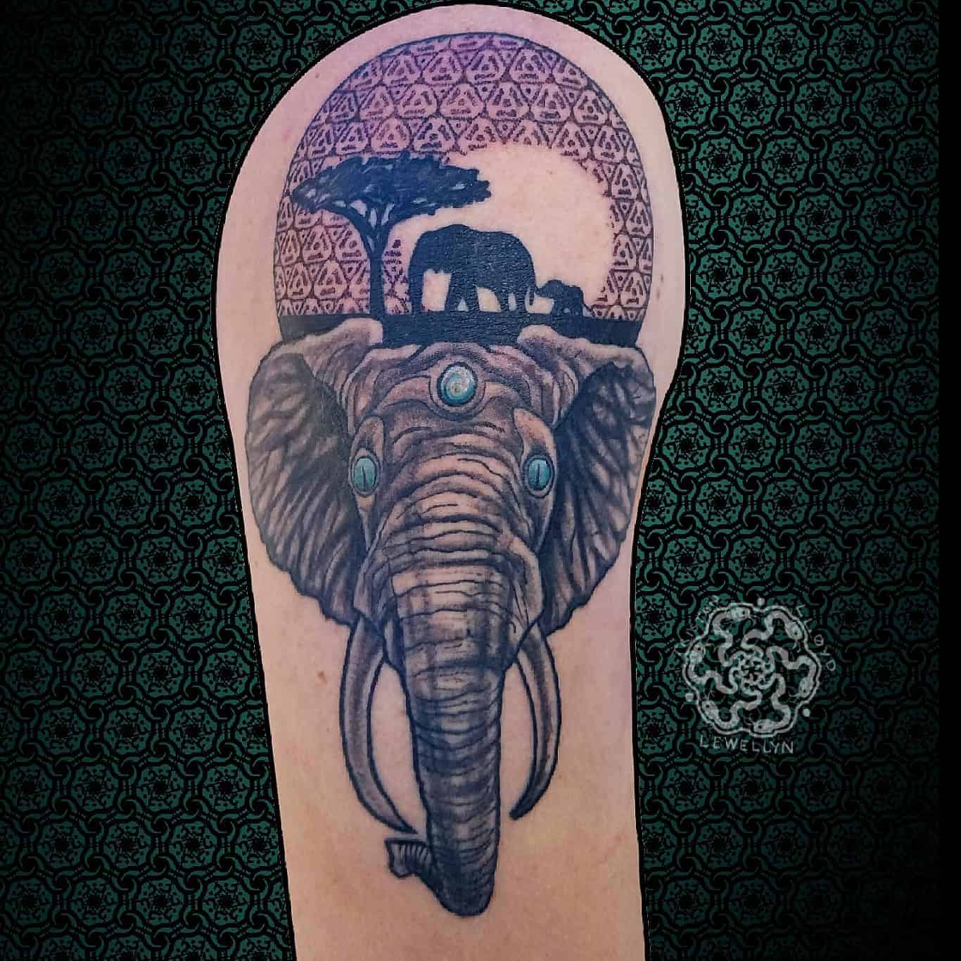 blackwork tattoo with neotraditional elephant on a upper arm