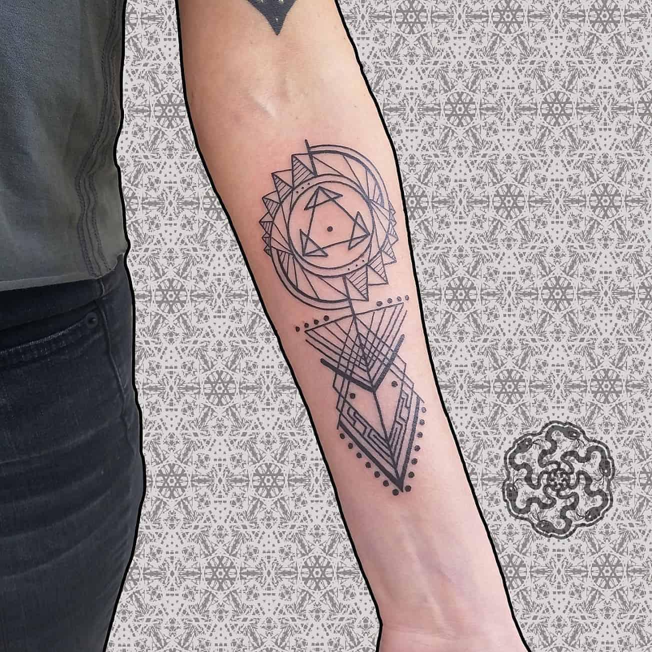 geometric minimalist tattoo on a forearm