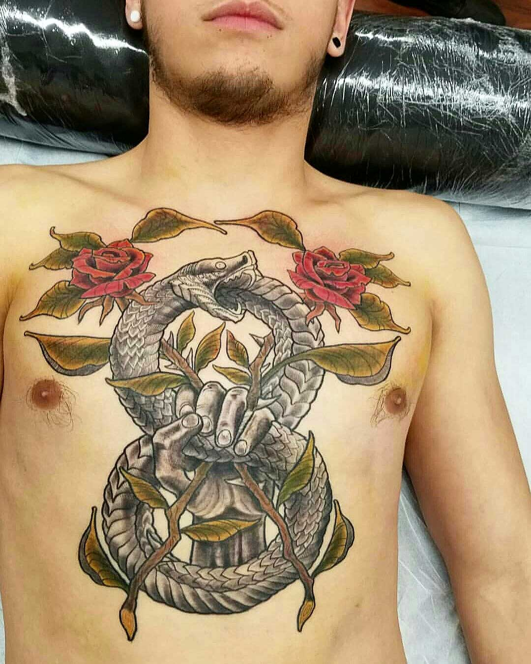 neo-traditional-style-tattoo-of-serpent-ouroboros-on-torso