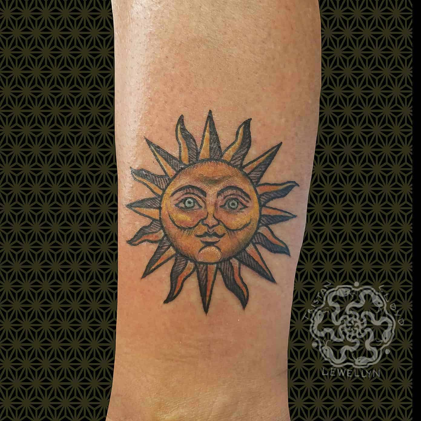 neotraditional sun witha face on an ankle
