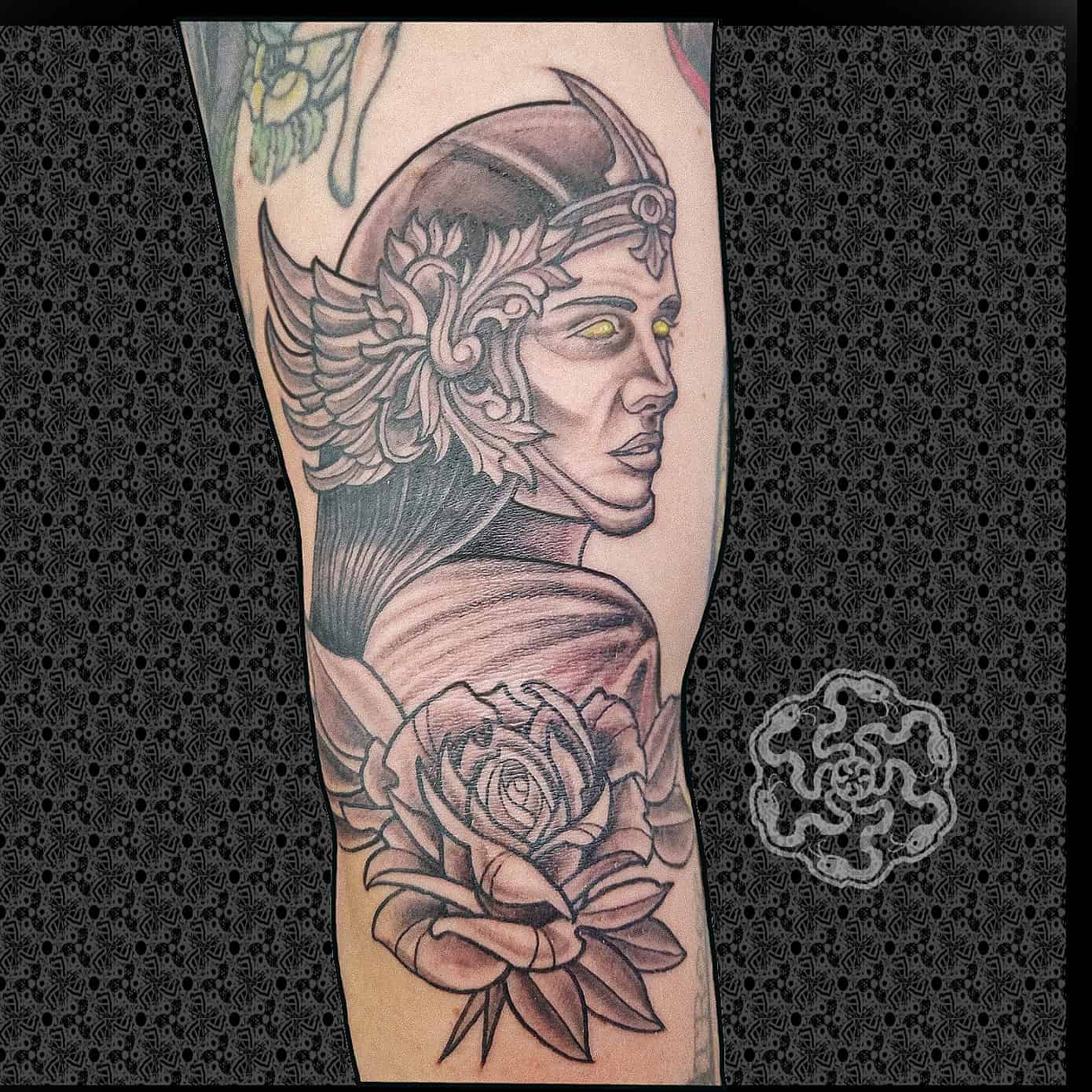 neotraditional tattoo in black and grey of valkyrie