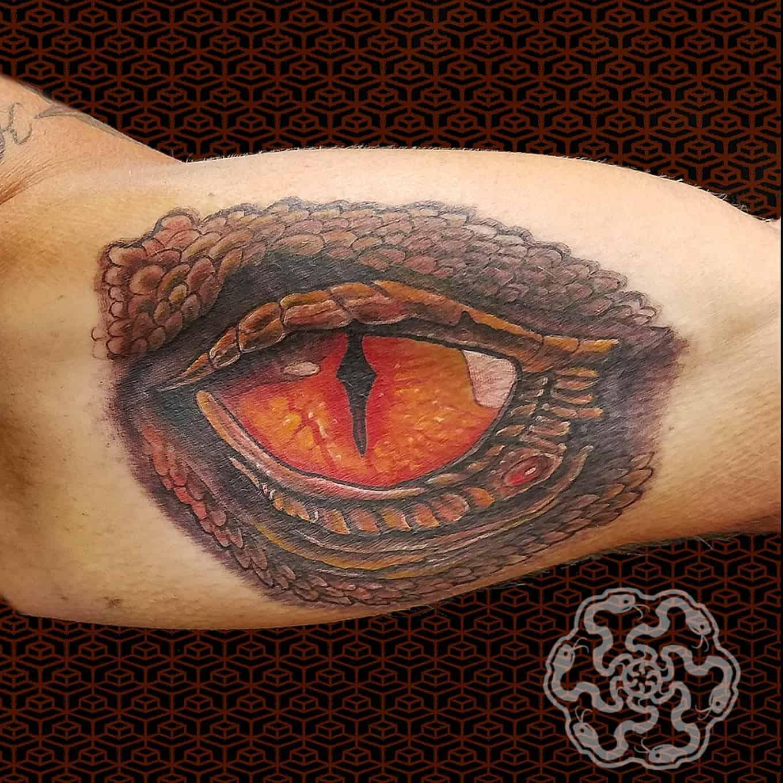 stylized realistic tattoo of a dragon eye