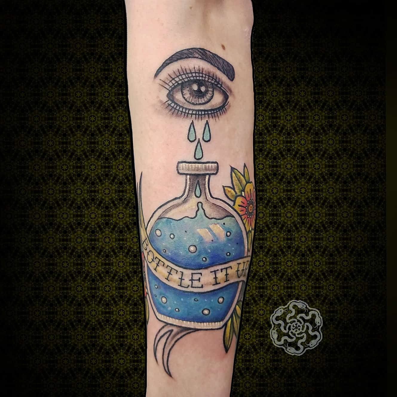 traditional tattoo of the %22bottle it up%22 image on a forearm