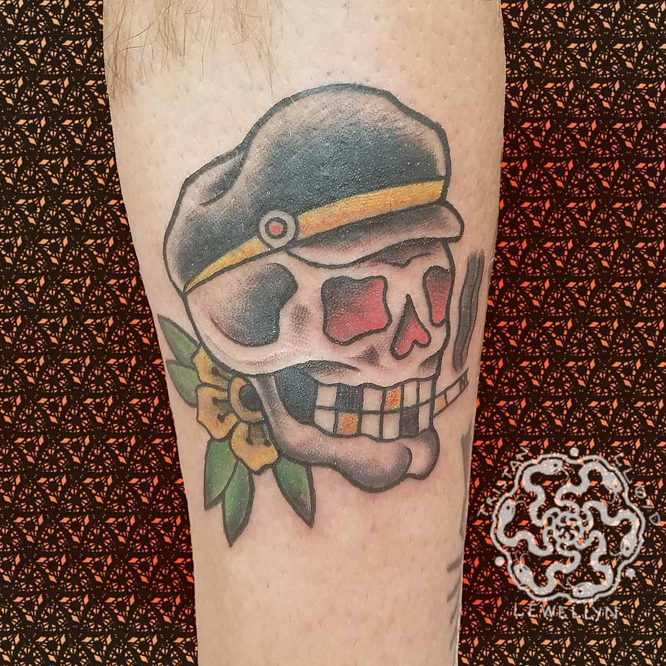 traditional tattoo ofg skull nad captain on a calf