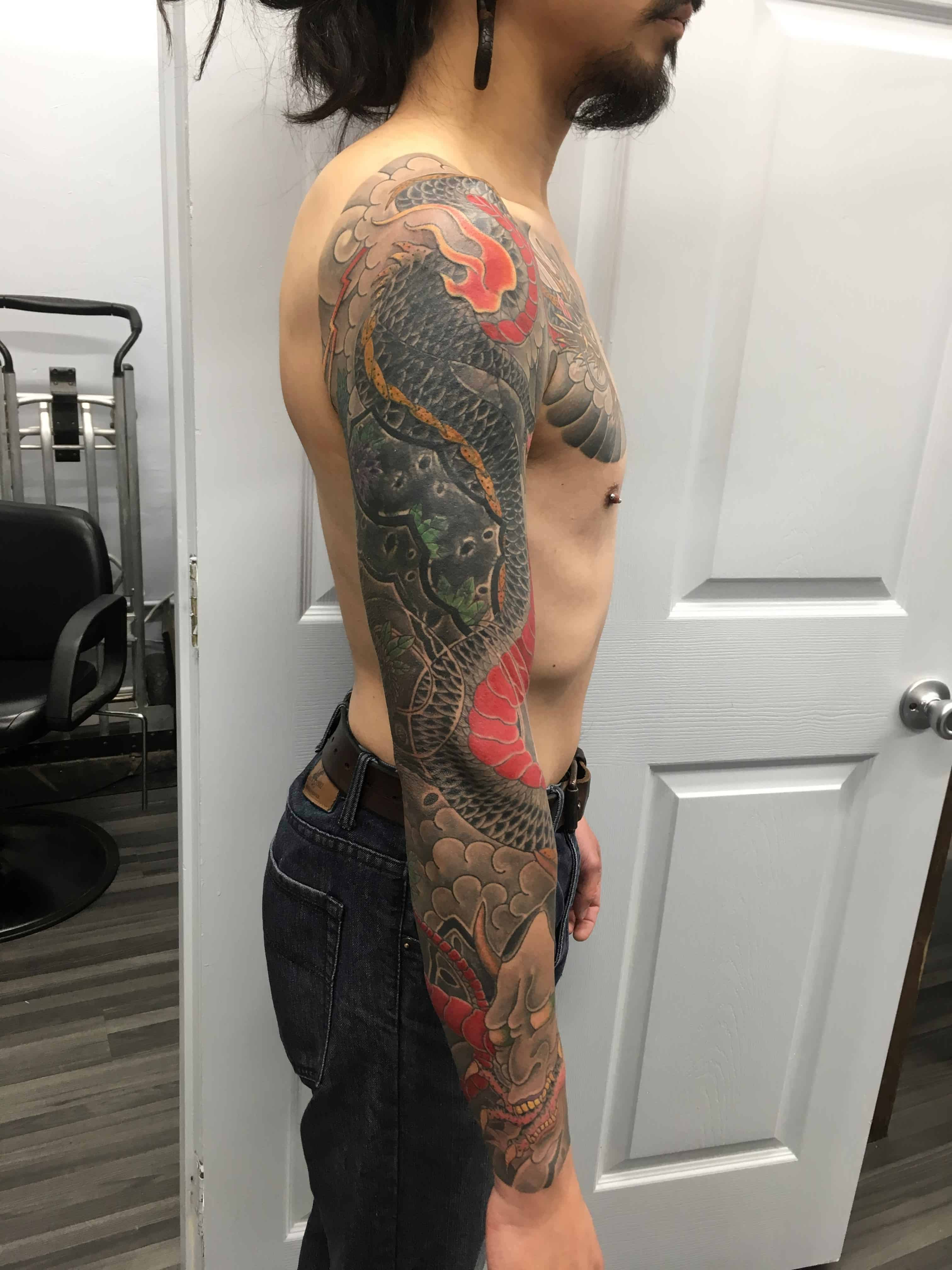 Cover-up-tattoo-of-Japanese-style-dragon-on-a-full-sleeve-by-Ei-Omiya