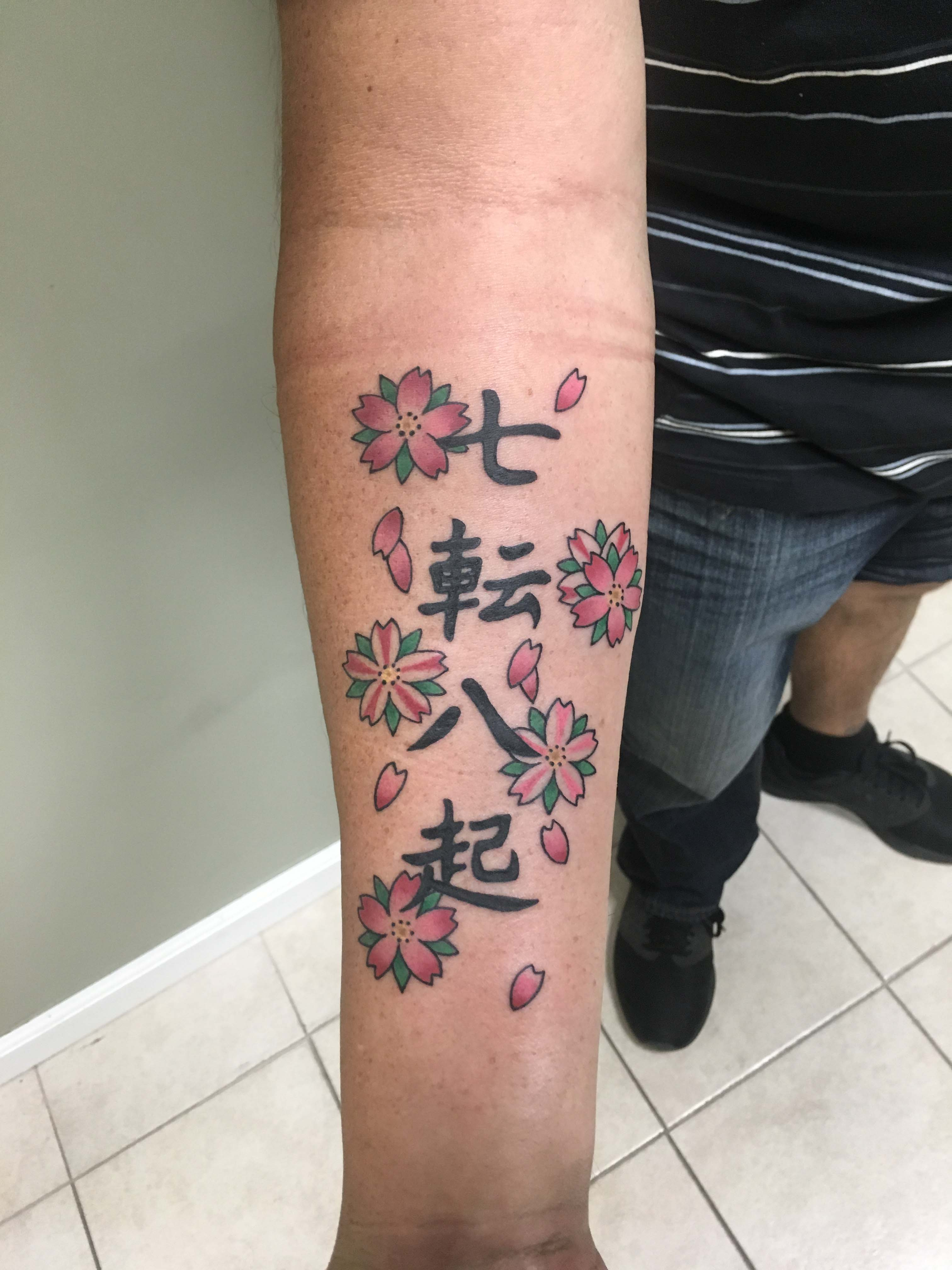 japanese lettering and cherry blossom tattoo by Ei Omiya at Funhouse Tattoo San Diego