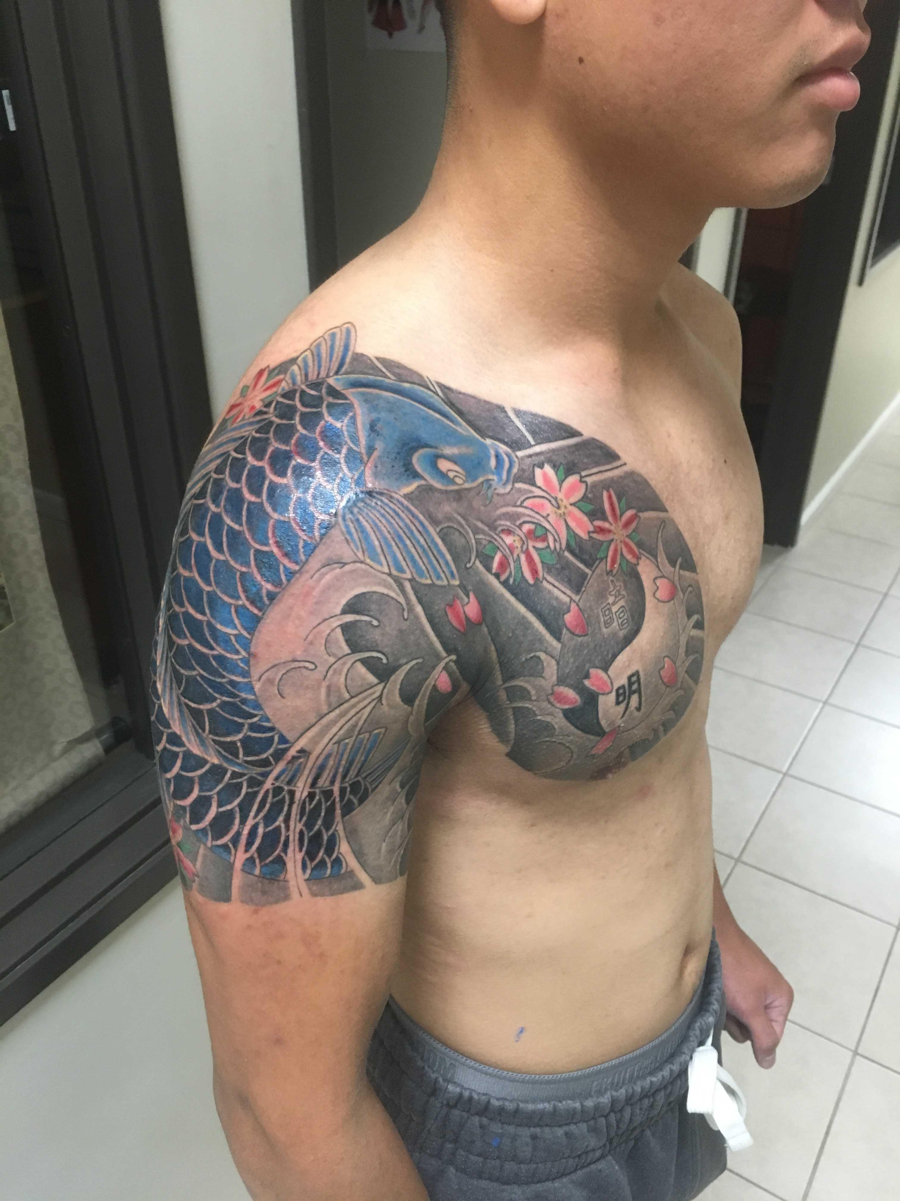 koi fish tattoo by Ei Omiya