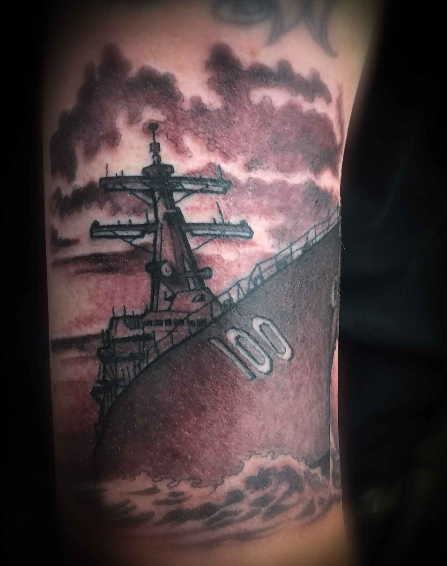 military-and-navy-warchip-in-black-and.-grey-by-resident-Funhouse-Tattoo-artist-Leo-Cadanezzi-in-San-Diego
