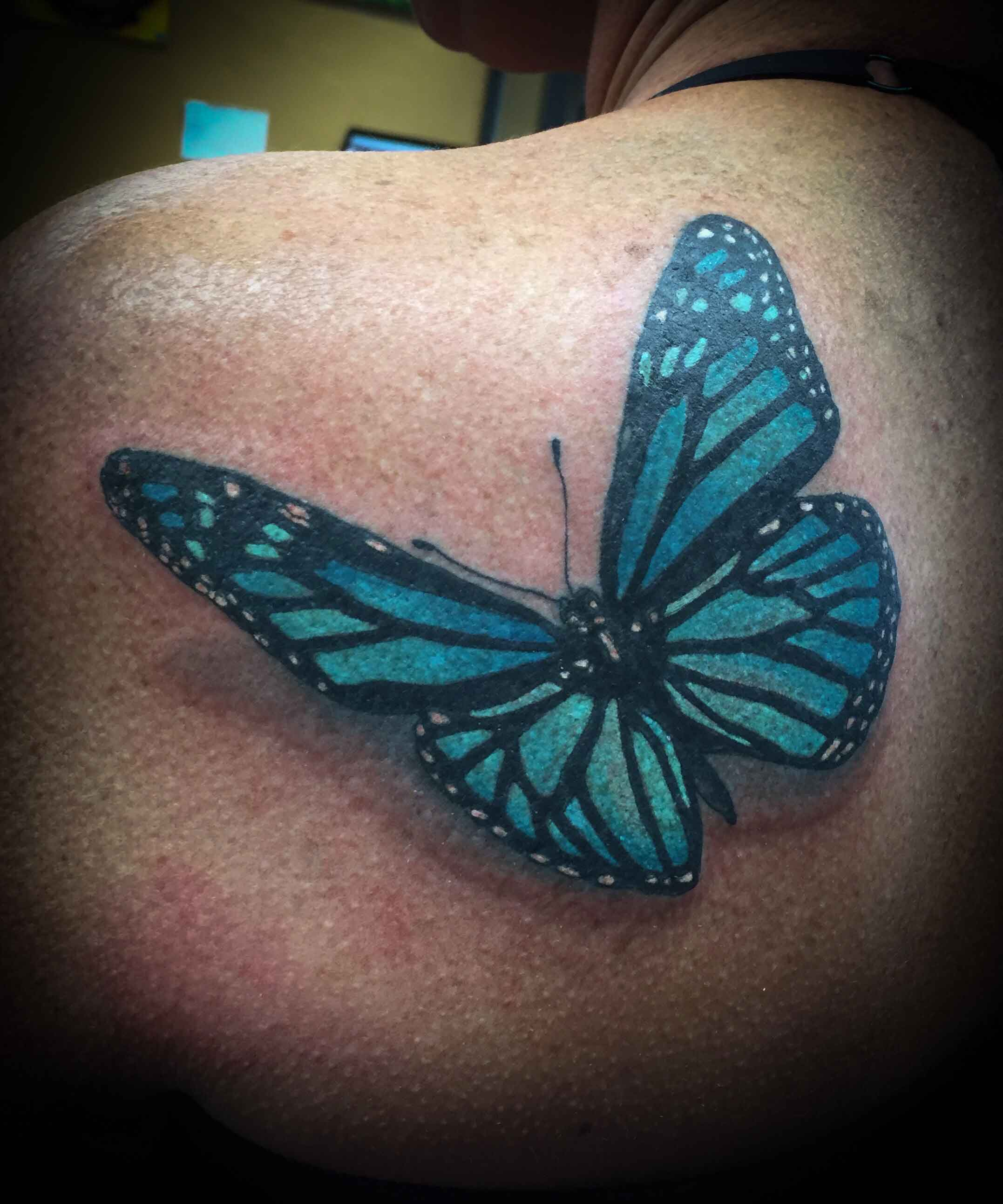 realism-tattoo-of-butterfly-by-resident-Funhouse-Tattoo-artist-Leo-Cadanezzi-in-San-Diego