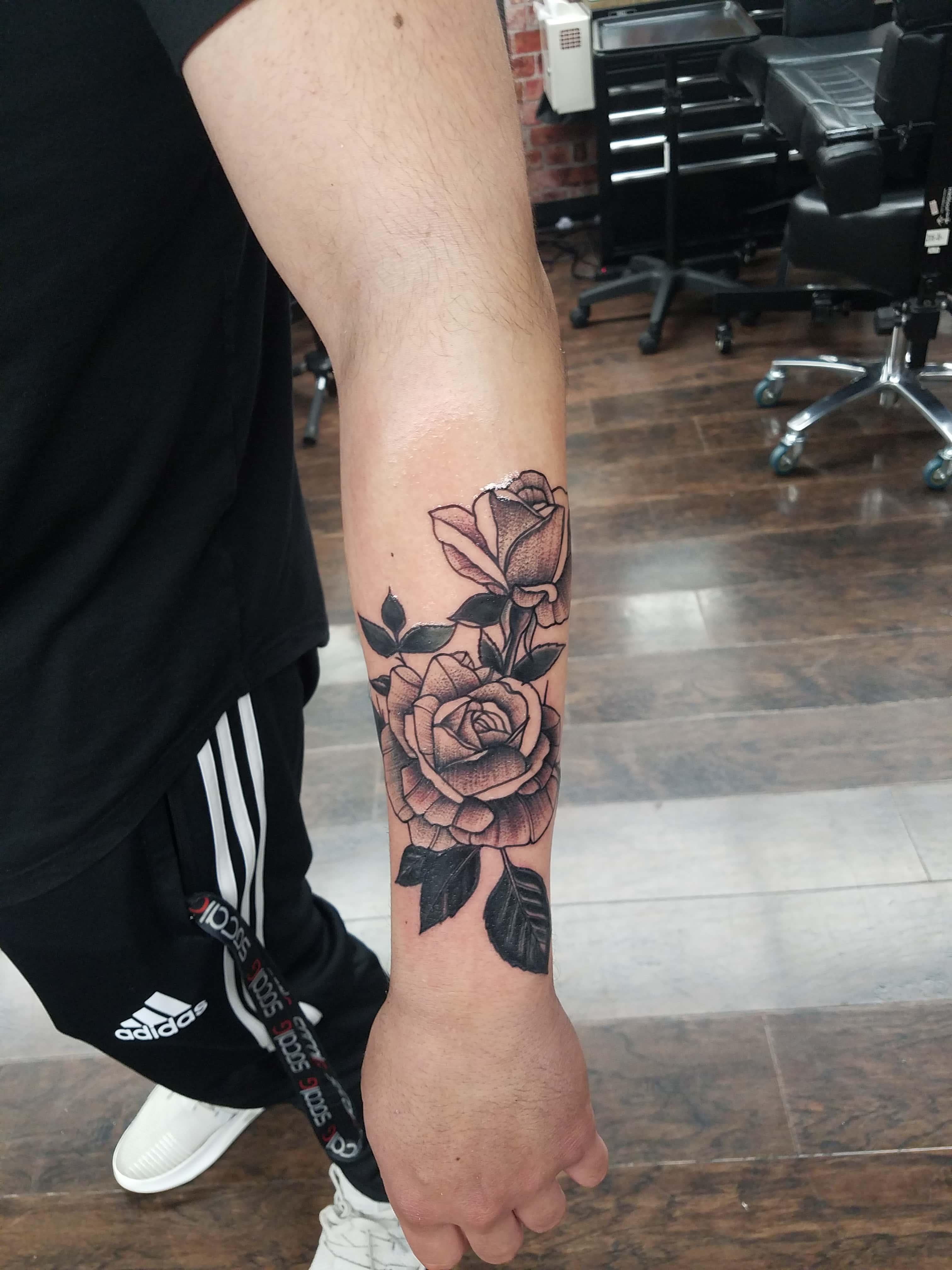 Dot work roses tattoo-min