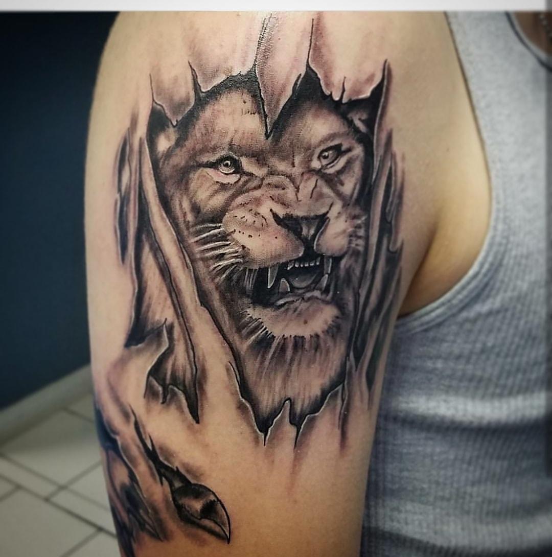 Lion black and grey tattoo-min