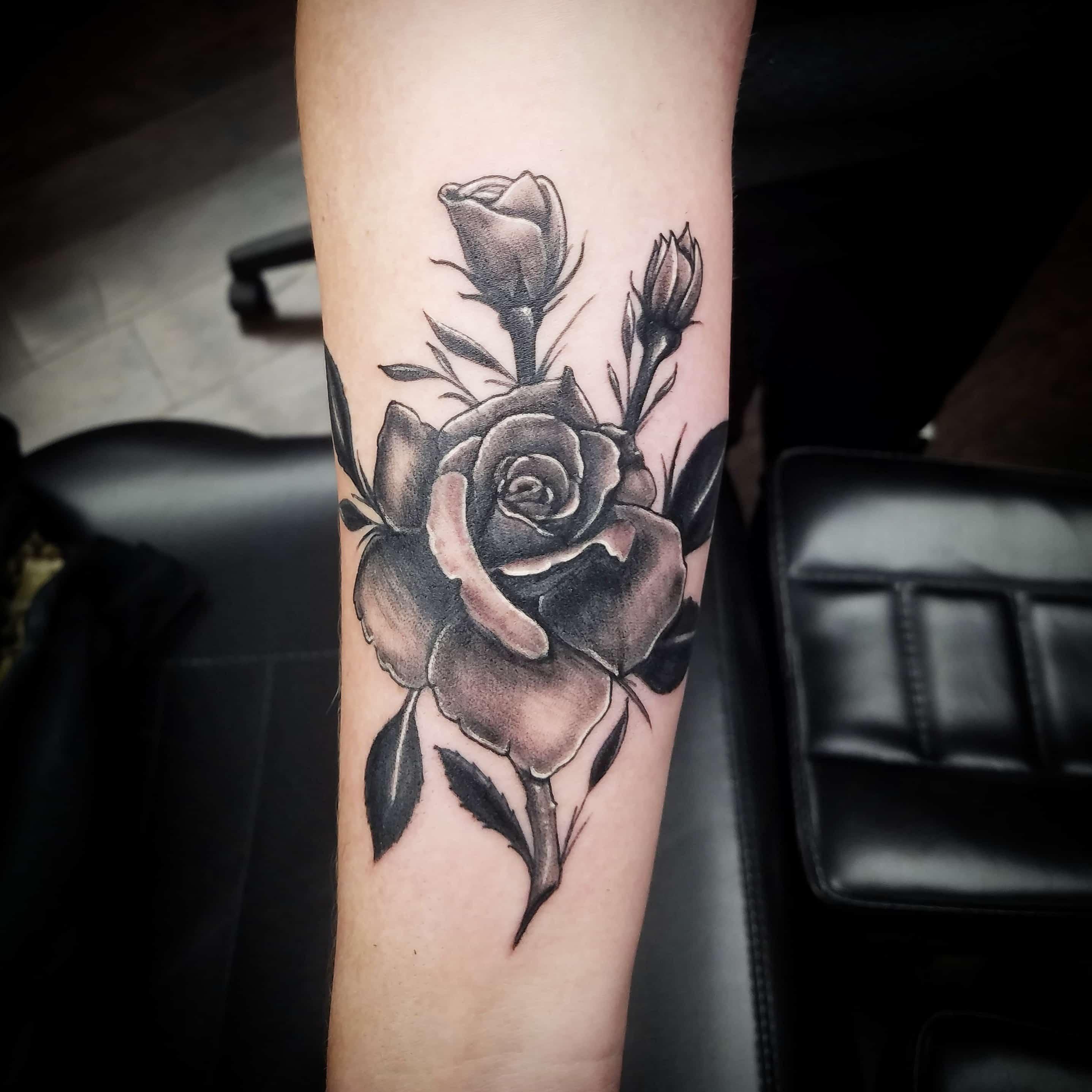 black and grey rose tattoo-min