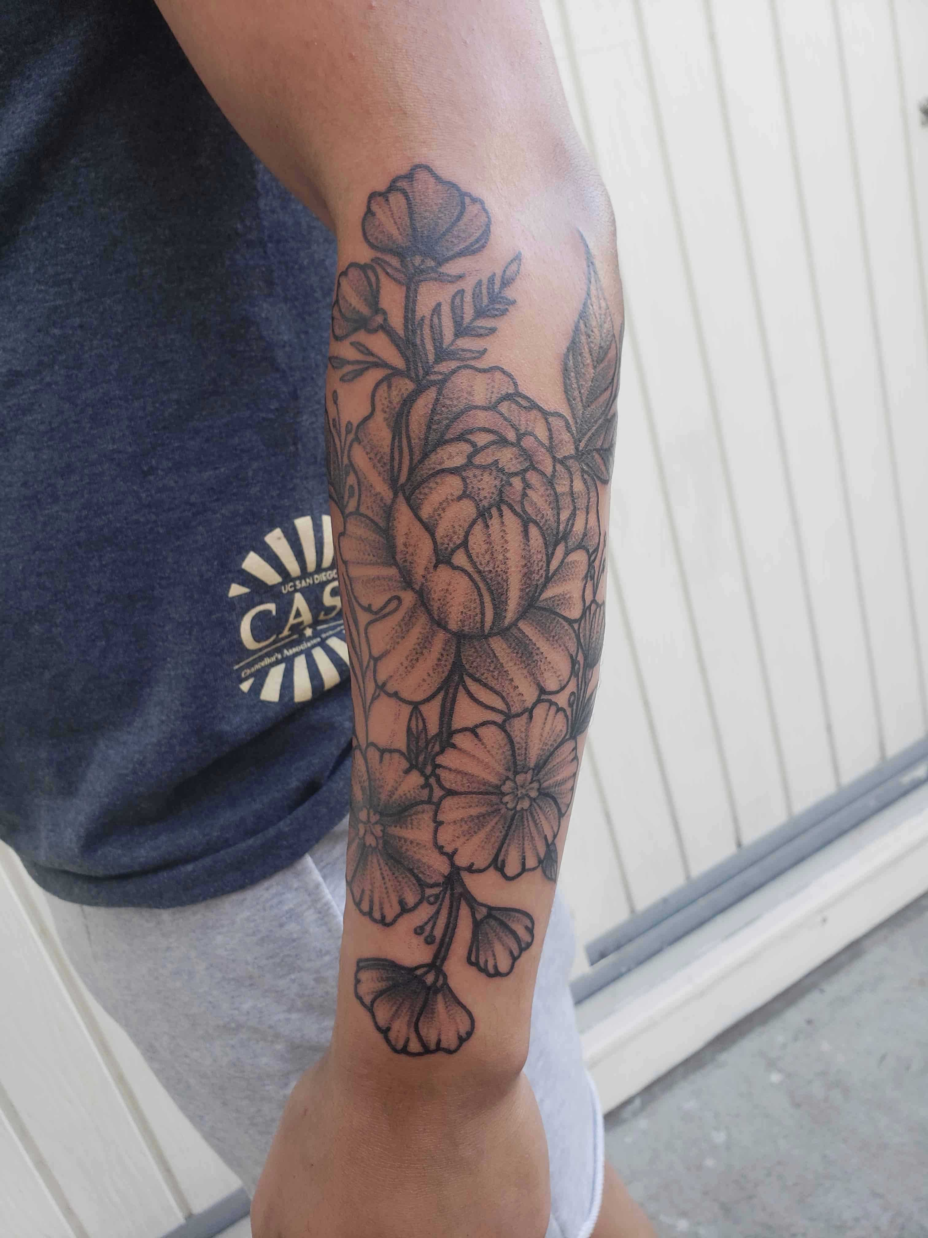 illustrated dotwork tattoo of flowers