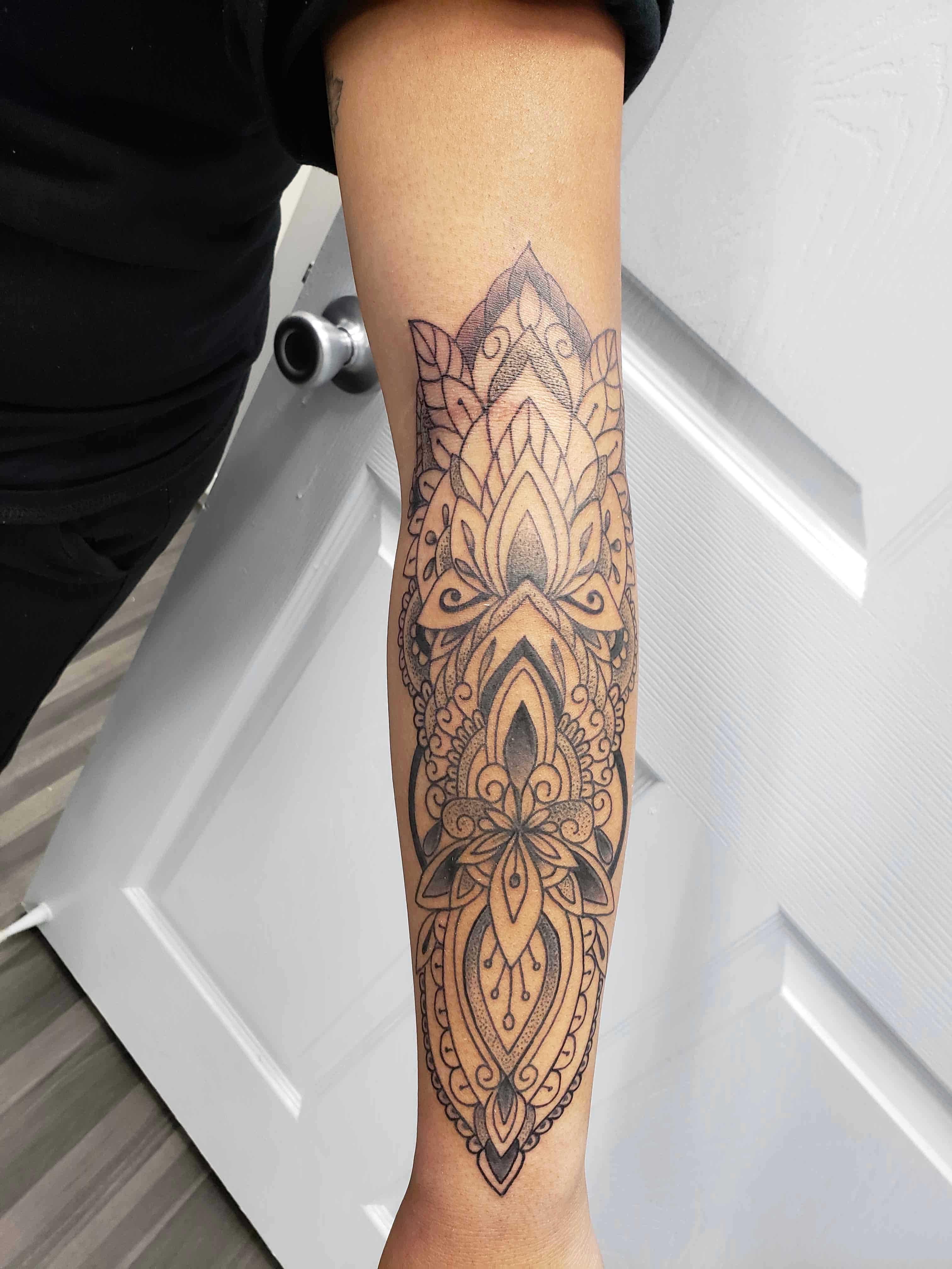 mandala tattoo on arm