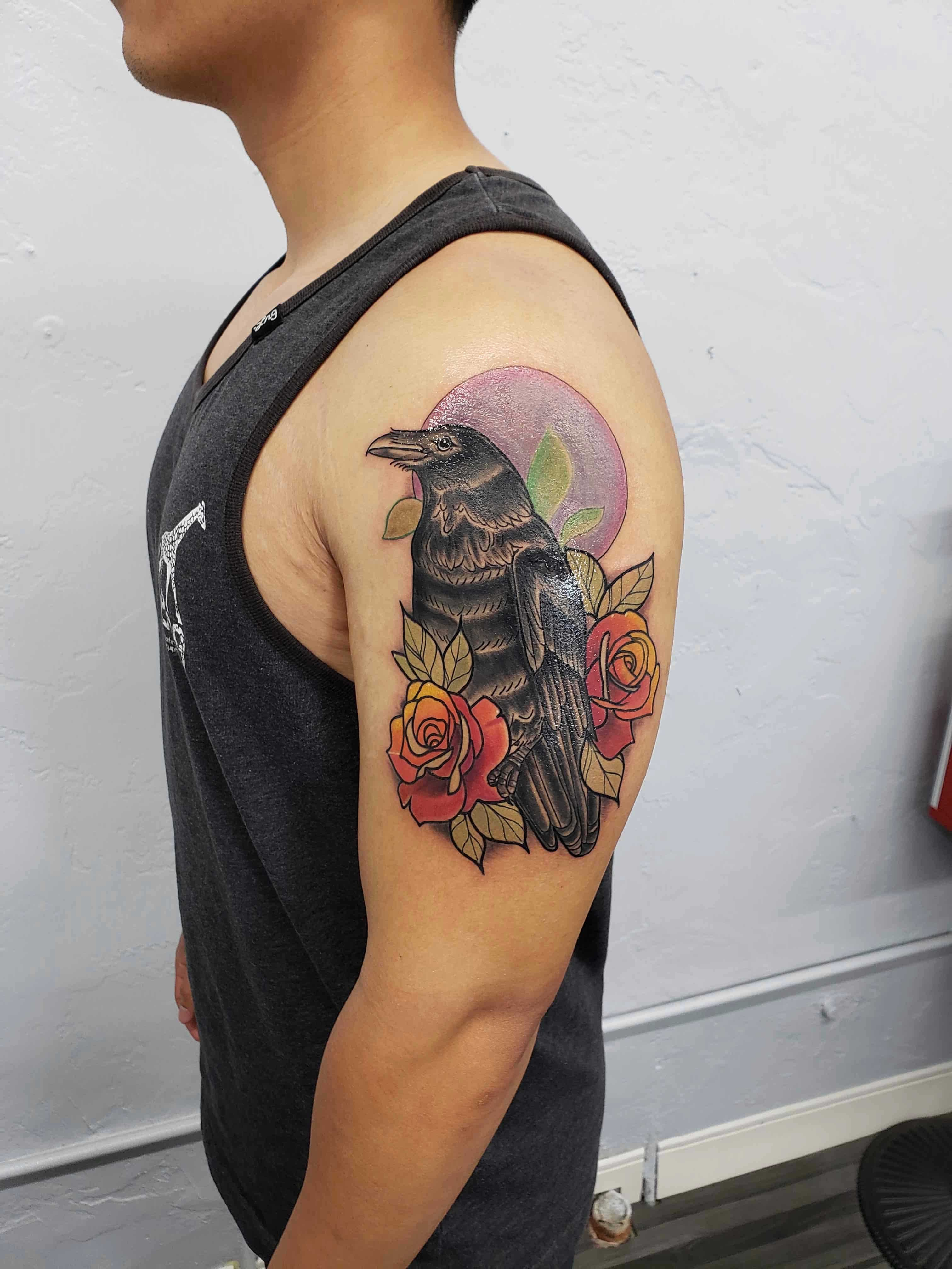 neotraditional crow and roses on shoulder