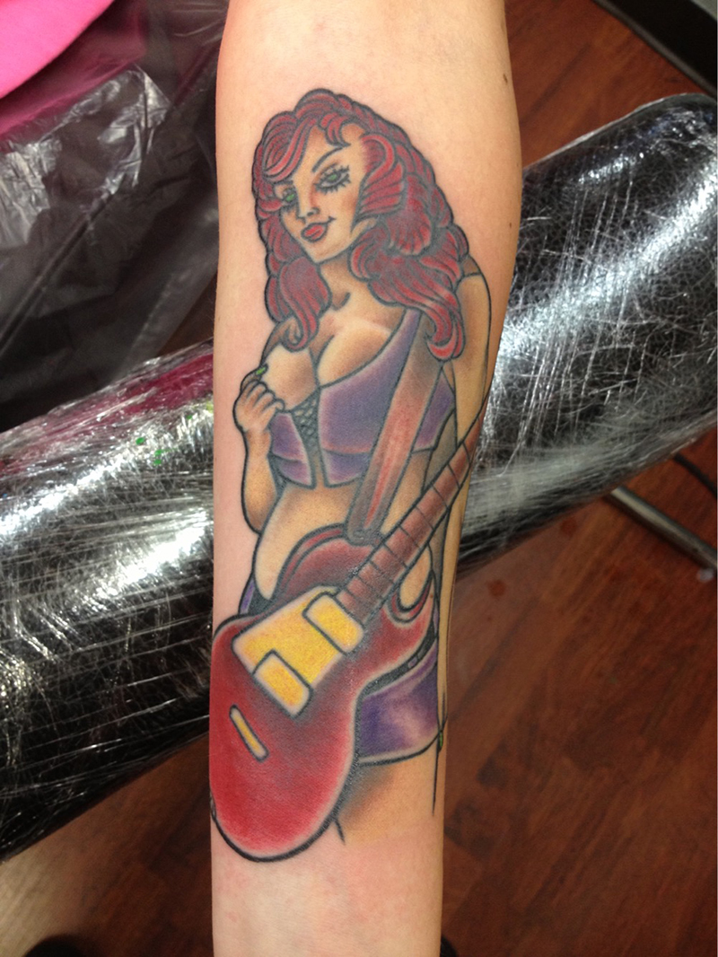 American traditional pin up girl with guitar