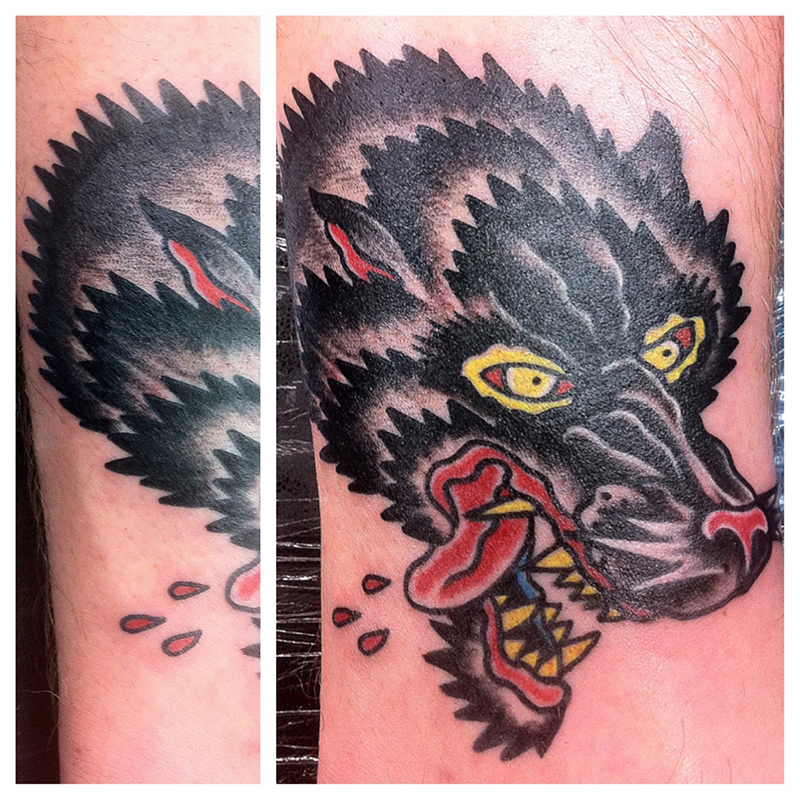 American traditional tattoo of wolf head