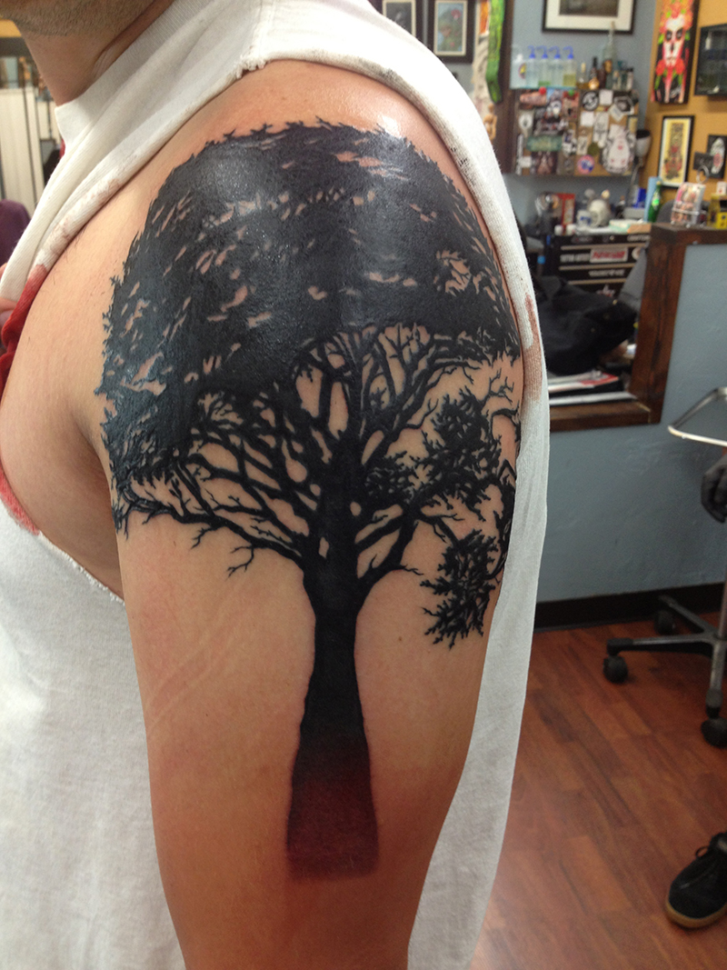 black tree silhouette tattoo