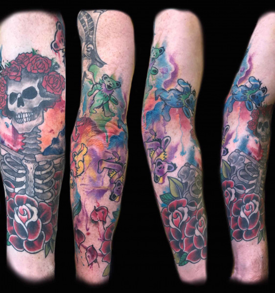 skeleton-and-rose-tattoos-on-arm-by-Roger-Solis