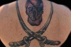 thumbs_black-and-gray-tattoo-of-skull-snd-swords-by-Roger-Solis