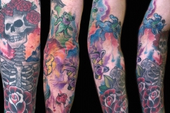 thumbs_skeleton-and-rose-tattoos-on-arm-by-Roger-Solis