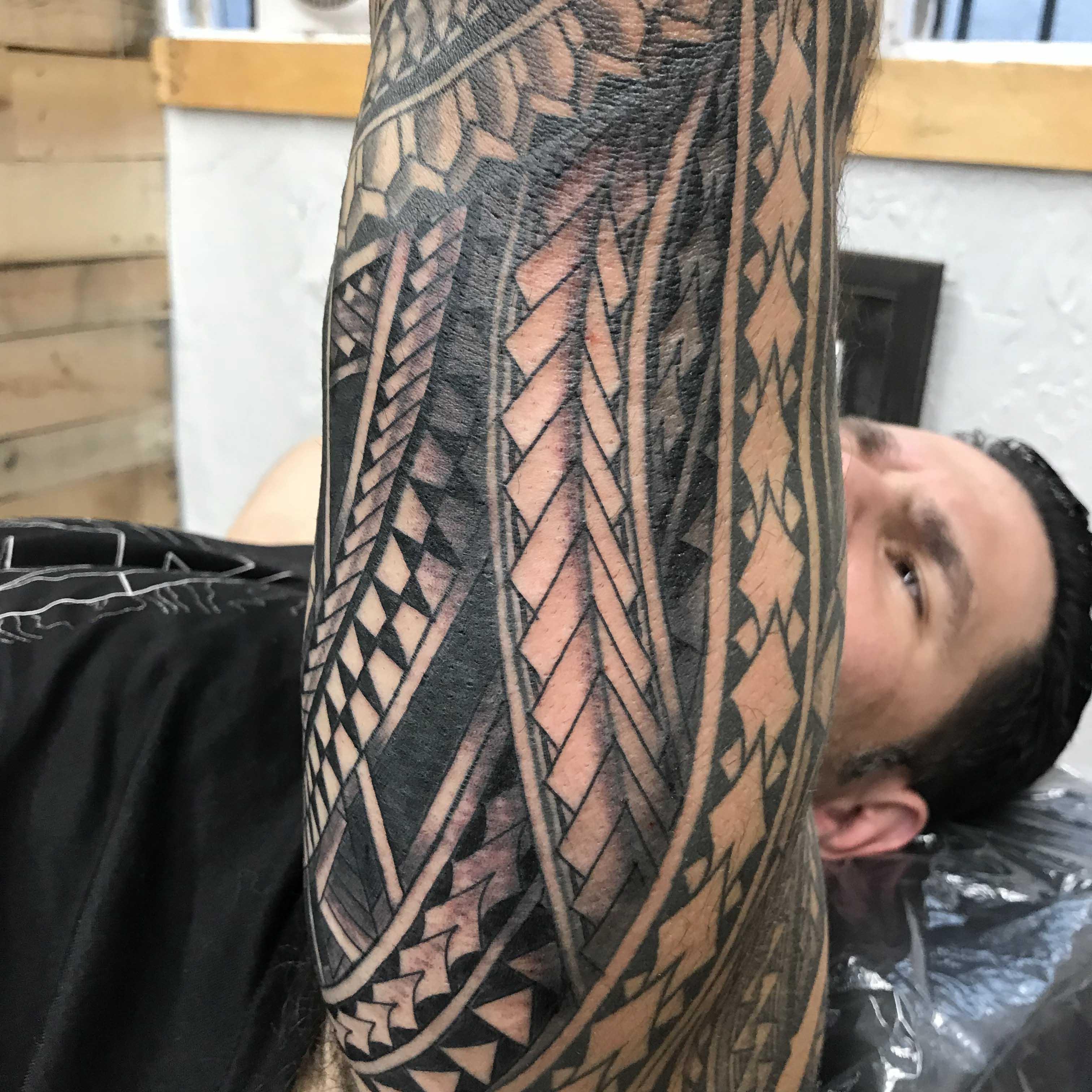 sleeve tribal tattoo by Seth Reynolds