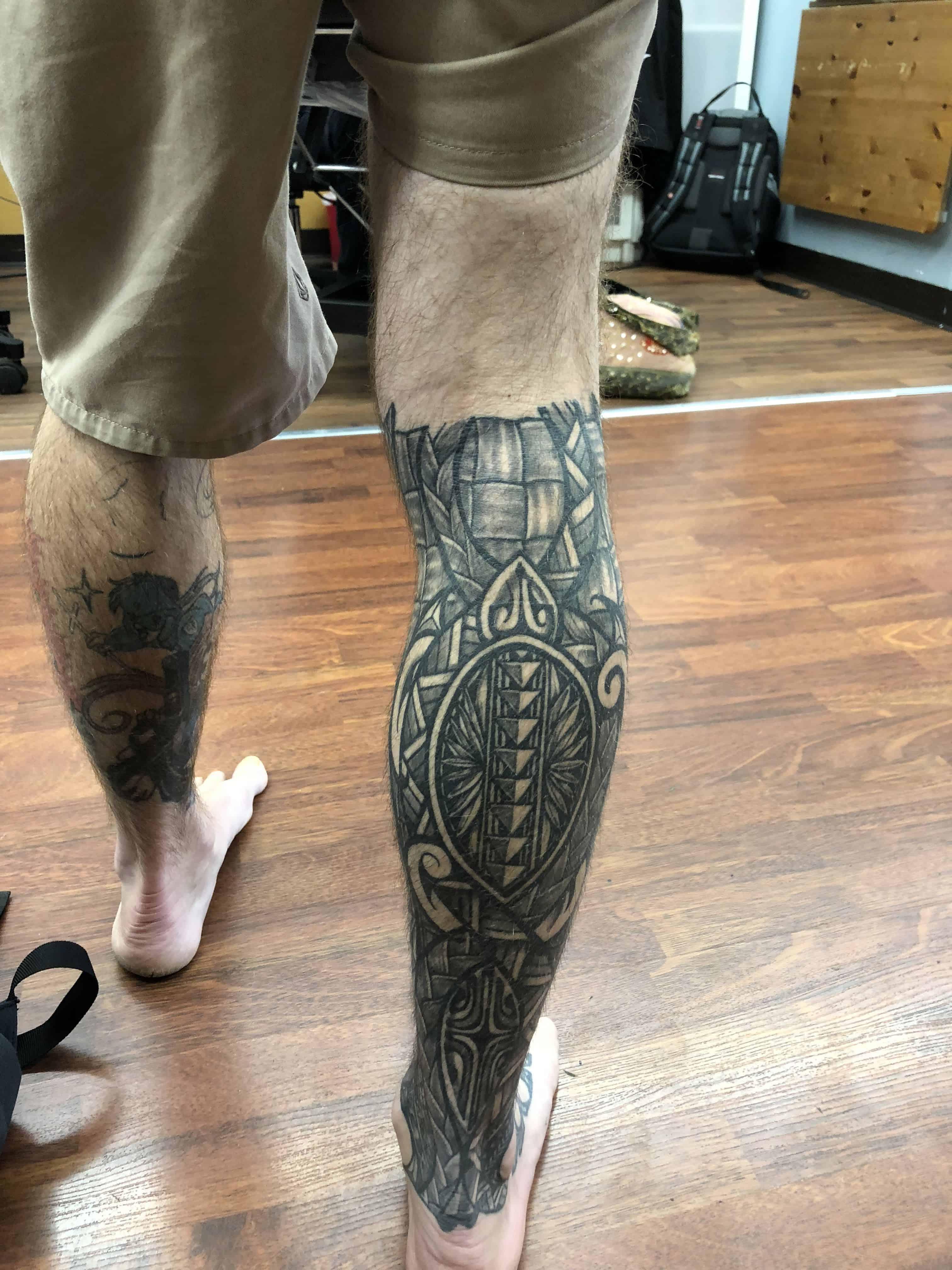 tribal leg tattoo back