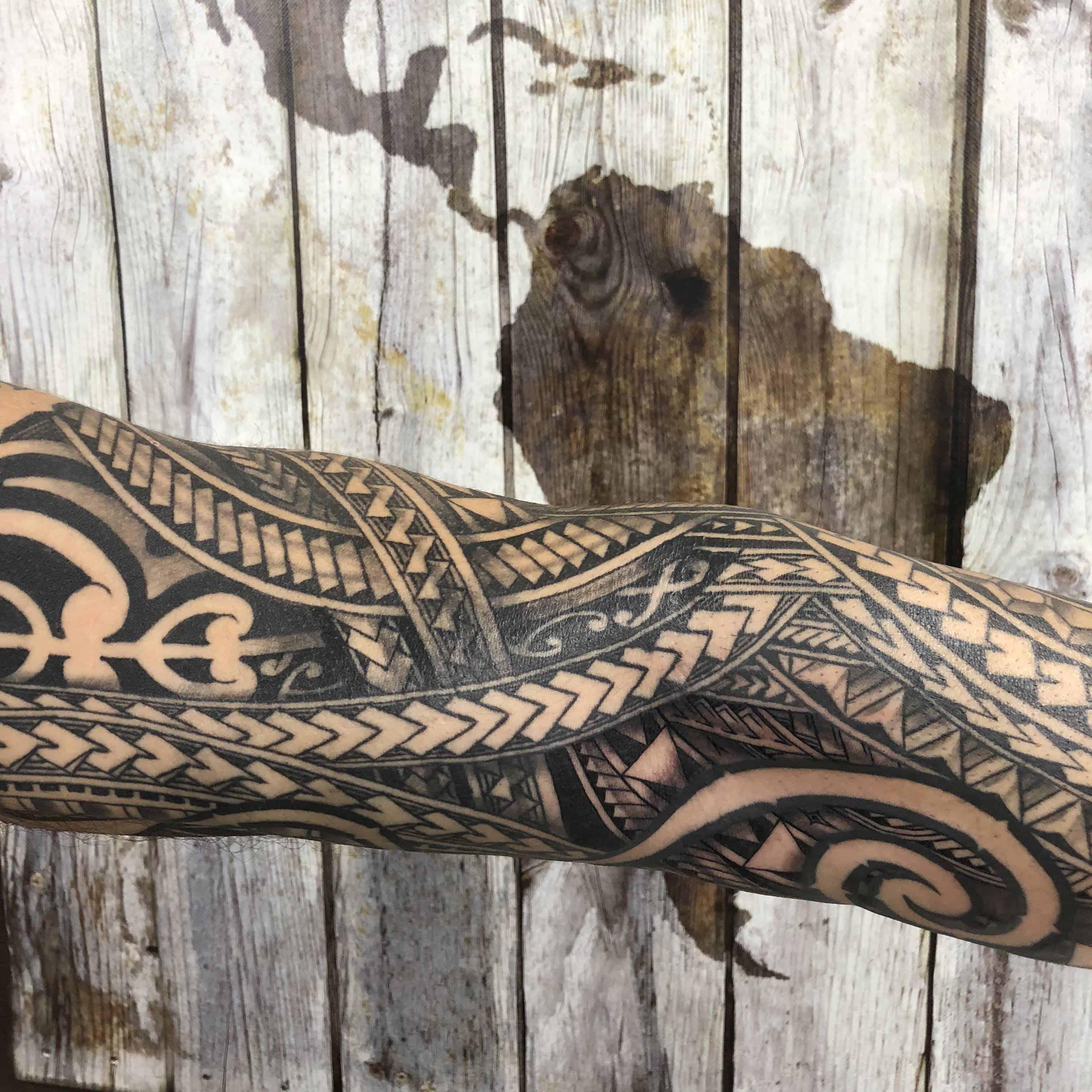 polynesian tattoo elbow