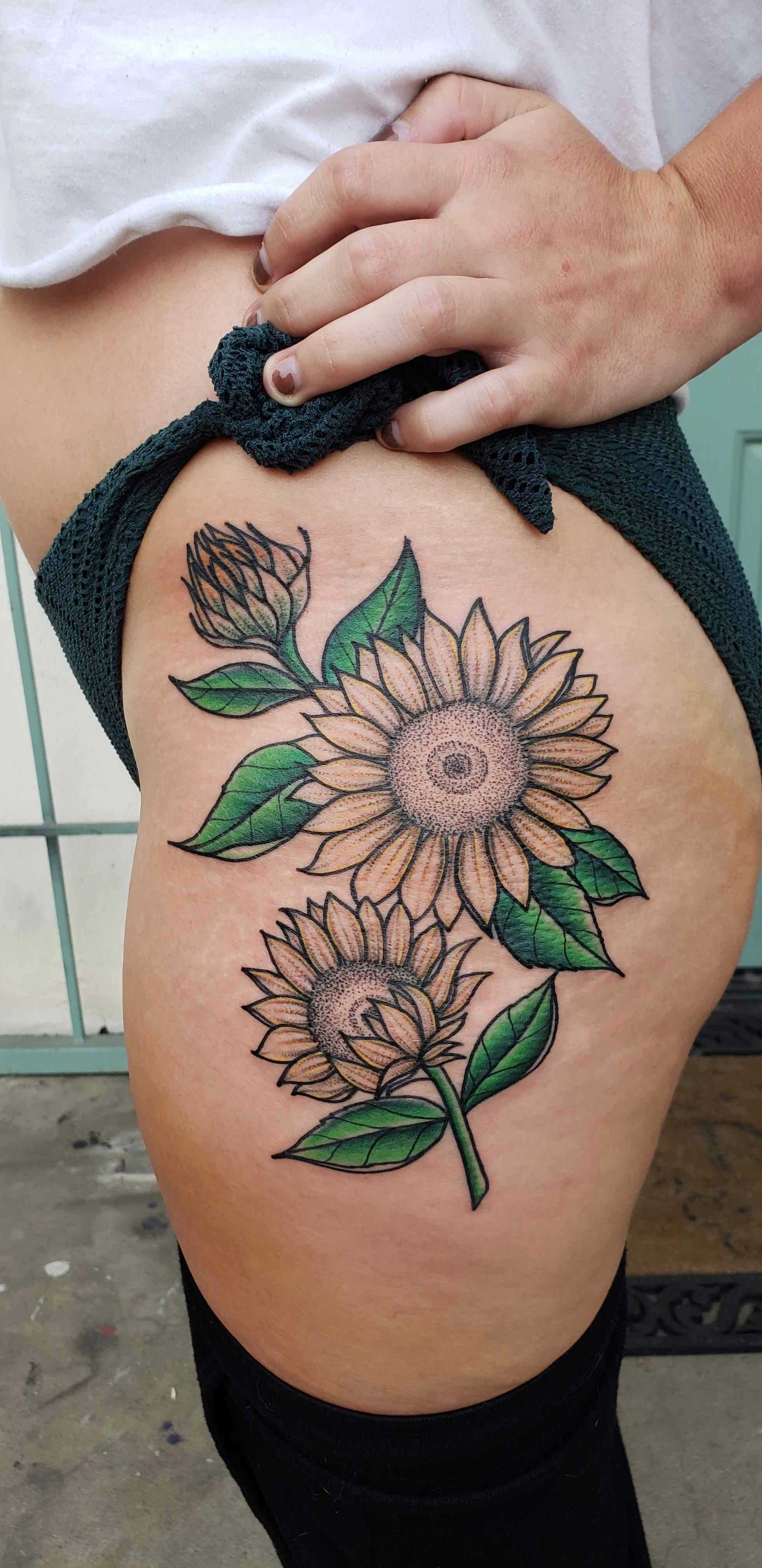 sunflower tattoo on the hip