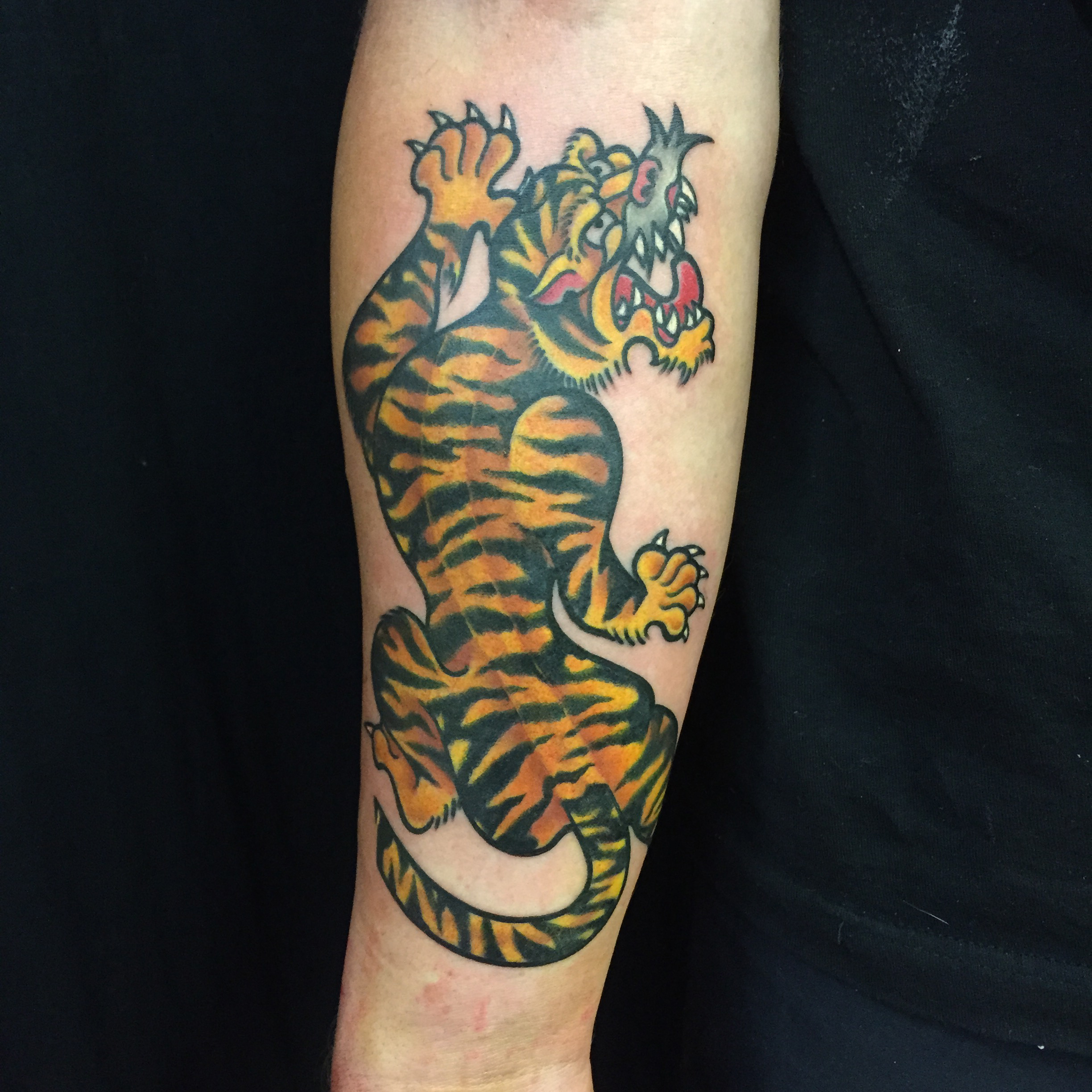 American traditional style tiger tattoo