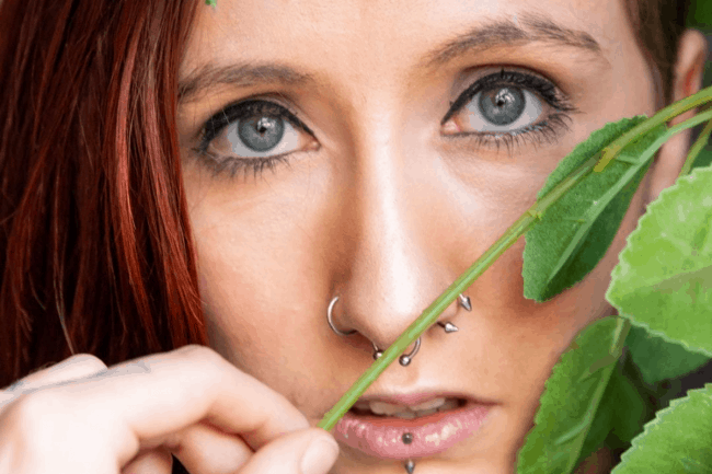picture of a girl with piercings in her nose and face