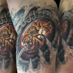 Incubating dragon fetus (inside arm of harley bio tattoo)